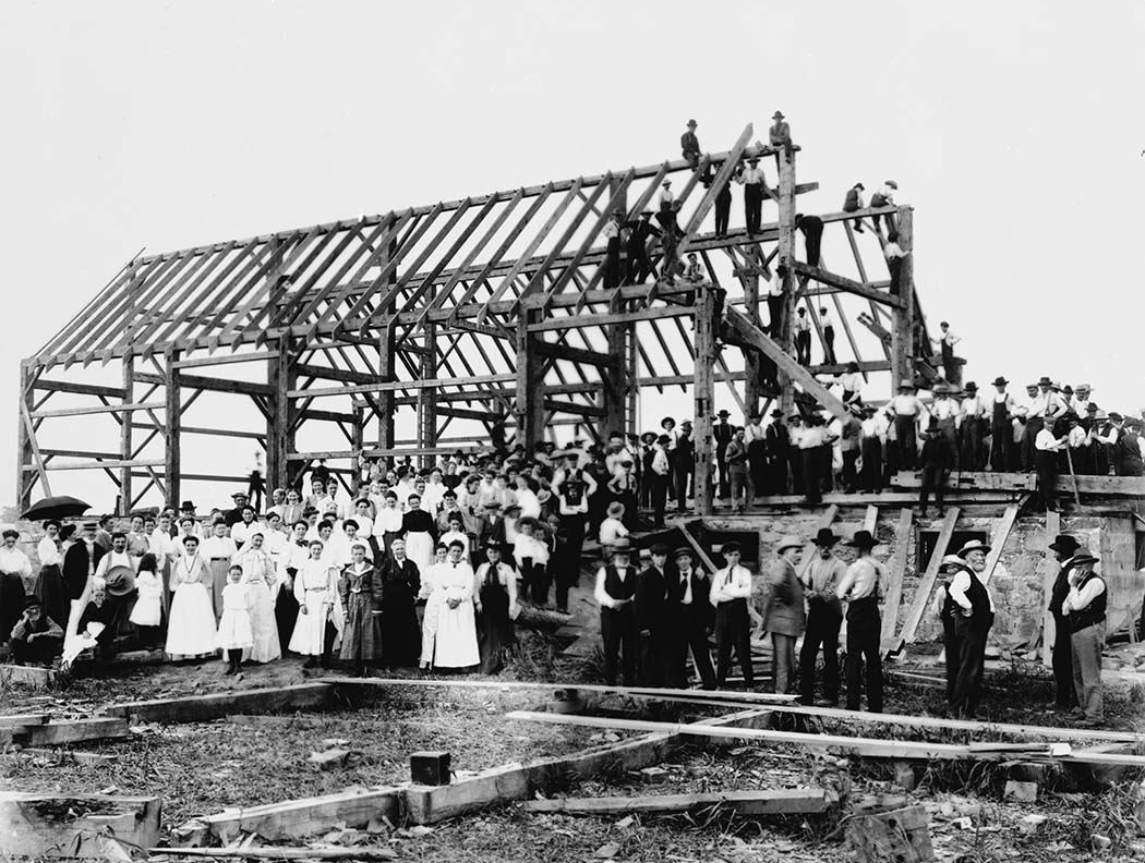 Barn Raising in Lansing, from Wikipedia (Copyright expired). http://en.wikipedia.org/wiki/File:Barn_raising_in_Lansing.jpg