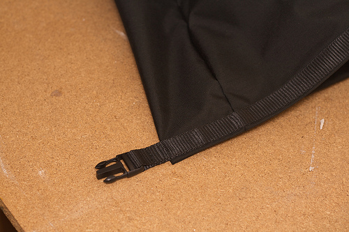Webbing and buckle on the drybag closure